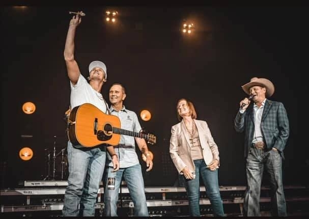 Parker McCollum (left) salutes the crowd at his Oct. 2 concert at the Cynthia Mitchell Pavilion. (Courtesy the city of Conroe)