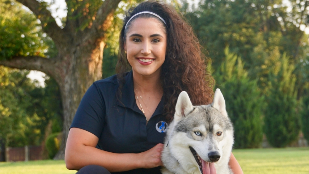 Yuni smiling with her husky