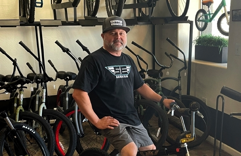 Owner Brian Morris sits on a P.K. Ripper, one of only 250 of its type ever made, at Freeride Bike Co. (Tom Blodgett/Community Impact Newspaper)
