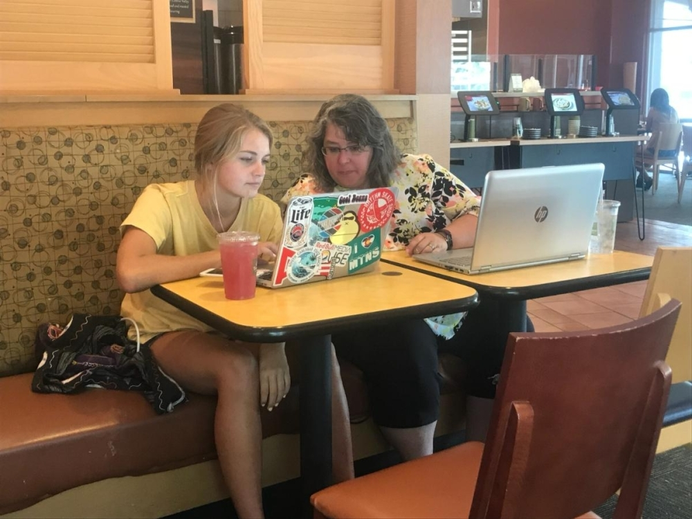 Annmarie Hatfield, right, meets with student Savannah Rocca to review college application materials. Today, most educational consultants meet with families and students online to ensure goals are met. (Courtesy College Inroads)