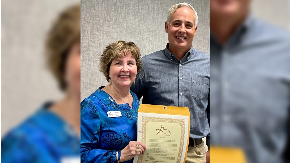 Georgetown Mayor Josh Schroeder, right, presents Assistance League of Georgetown Area President Suzan Brown with a certificate declaring Sept. 20, 2021 Assistance League of Georgetown Area Day. (Courtesy Assistance League of Georgetown Area)