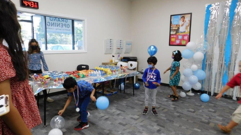 Students celebrate the grand opening of Kumon on Louetta Road in Spring on Oct. 8. (Courtesy Aisha Subhani)
