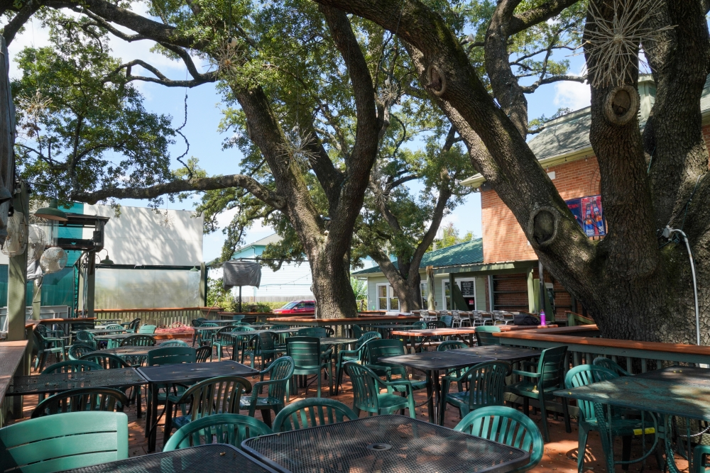 Live Oak Grill will reopen Oct. 15 with a new food and drink menu. The eatery is known for its shaded patio beneath five 130-year-old live oak trees. (Courtesy Dylan McEwan)