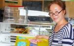 woman holding donut tray