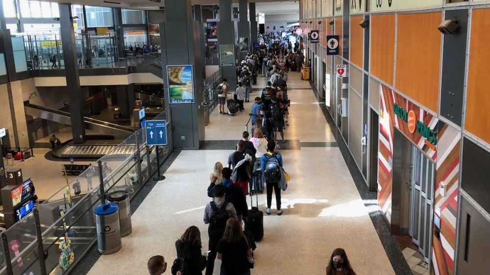 Passengers wait in a security checkpoint line at the Austin-Bergstrom International Airport. The three existing checkpoints would receive machine upgrades but would remain largely unchanged. (Benton Graham/Community Impact Newspaper)