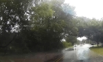 A dash cam still shows flooding on Brandt Road after rain. (Courtesy Jon Iken)
