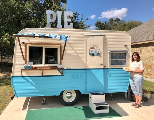 Lisa Franke stands with her trailer, Lucille, out of which she runs Lulu's Pie Shoppe. (Brittany Andes/Community Impact Newspaper)
