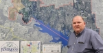 man standing in front of map