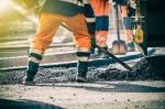 Road worker shoveling