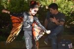 Aurelia Flowers dances in her butterfly-themed Halloween costume at Butterfly Flutterby. (Anjali Krishna/Community Impact Newspaper)