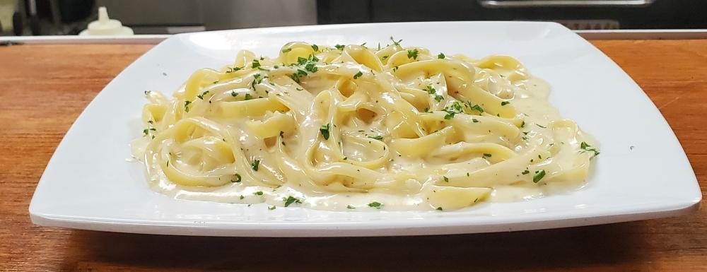 An Italian classic, the Fettuccine Alfredo ($10) is a homemade specialty at The Purple Garlic. (Jarrett Whitener/Community Impact Newspaper)