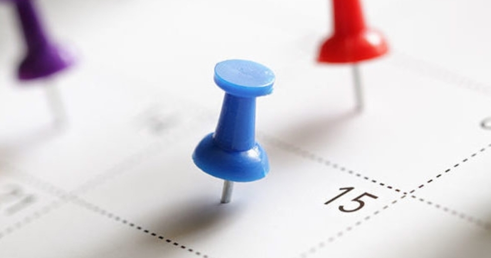 calendar with push pin on it