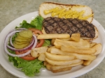 The Homestyle Hamburger ($7.99) made with lean ground beef and served with lettuce, tomato, pickles and onion.