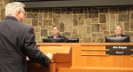 Mayor Derek France and Town Council Member Jim Engel listen to comments from Lewisville ISD Board President Tracy Scott Miller at the Oct. 4 council meeting about the potential for LISD property in Flower Mound. (Samantha Van Dyke/Community Impact Newspaper)