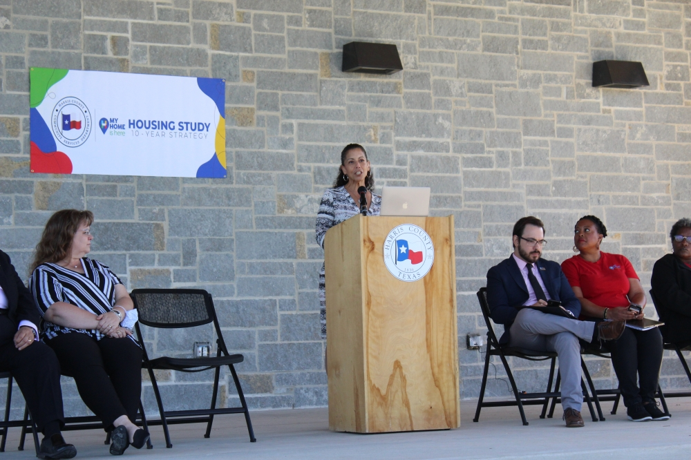 Heather Lagrone, Adrienne Holloway, Luis Guajardo, Maya Ford and Charleen Jones sit onstage while Holloway introduces the audience to the Harris County Housing Needs Assessment study on Oct. 19. (Emily Lincke/Community Impact Newspaper)