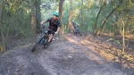 Mountain bikers and the city are working together to create a short course near Lynn Gripon Park at Countryside. Here, a couple of those bikers test out the course. (Jake Magee/Community Impact Newspaper)
