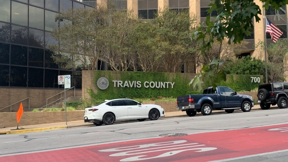 Photo of the Travis County administration building and sign