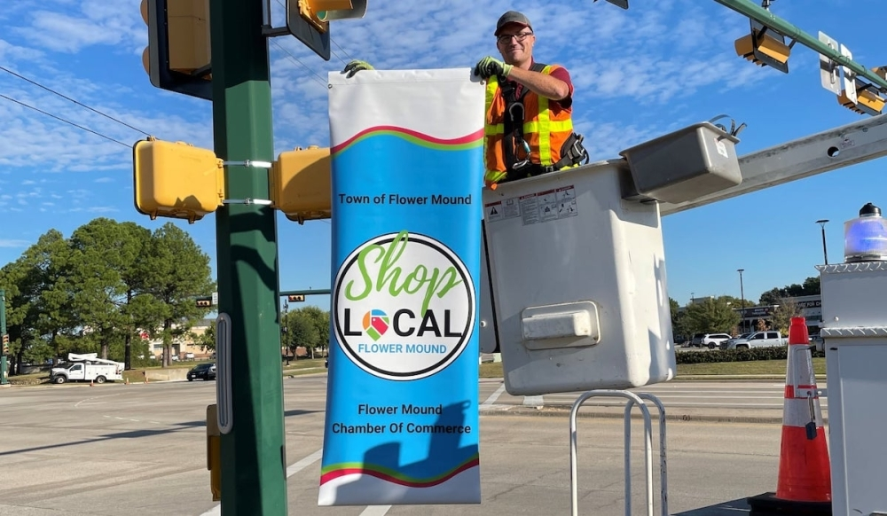shop local banner being set up.