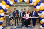 President and CEO George Hampton and Brentwood Mayor Rhea Little (center) facilitated a ribbon-cutting ceremony at Currax's new headquarters Sept. 29. (Courtesy Currax Pharmaceuticals)