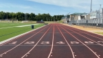 running track with worn sections