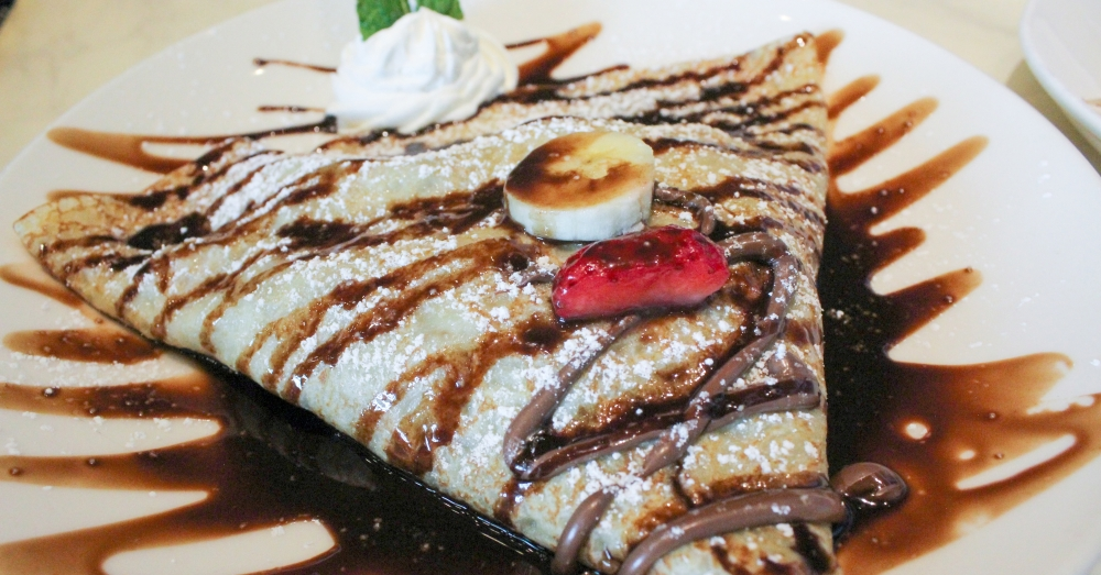 The Parisian Nutella ($7.95) is one of nine sweet crepes on the menu and is filled with Nutella's famous hazelnut cocoa spread, strawberries and bananas. (Hannah Zedaker/Community Impact Newspaper)