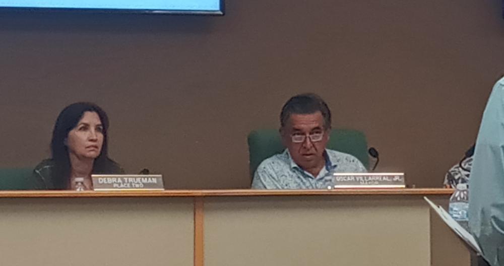 Hollywood Park Council Member Deborah Trueman and Mayor Oscar Villarreal listen to Town Secretary Patrick Aten's presentation on possible new rules for the town's swimming pool. (Edmond Ortiz/Community Impact Newspaper)