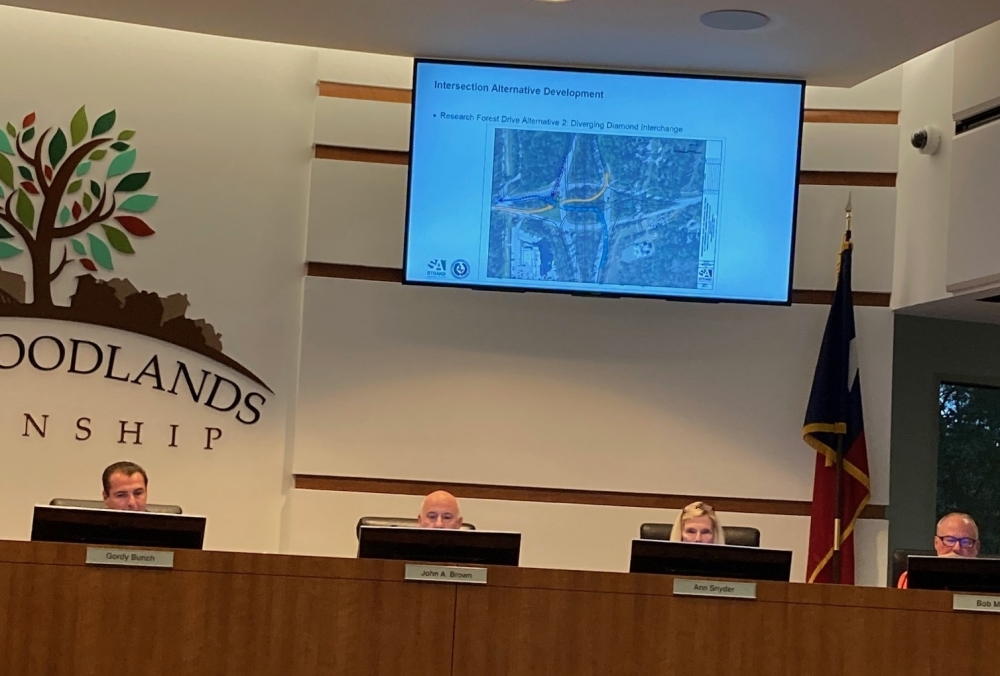 The Woodlands board members seated the podium