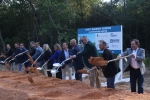 Conroe city government and business officials toss dirt with shovels