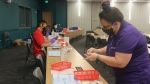 Photo of Austin Community College pharmacy students preparing vaccines
