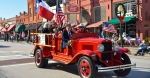 old fashioned fire truck in parade